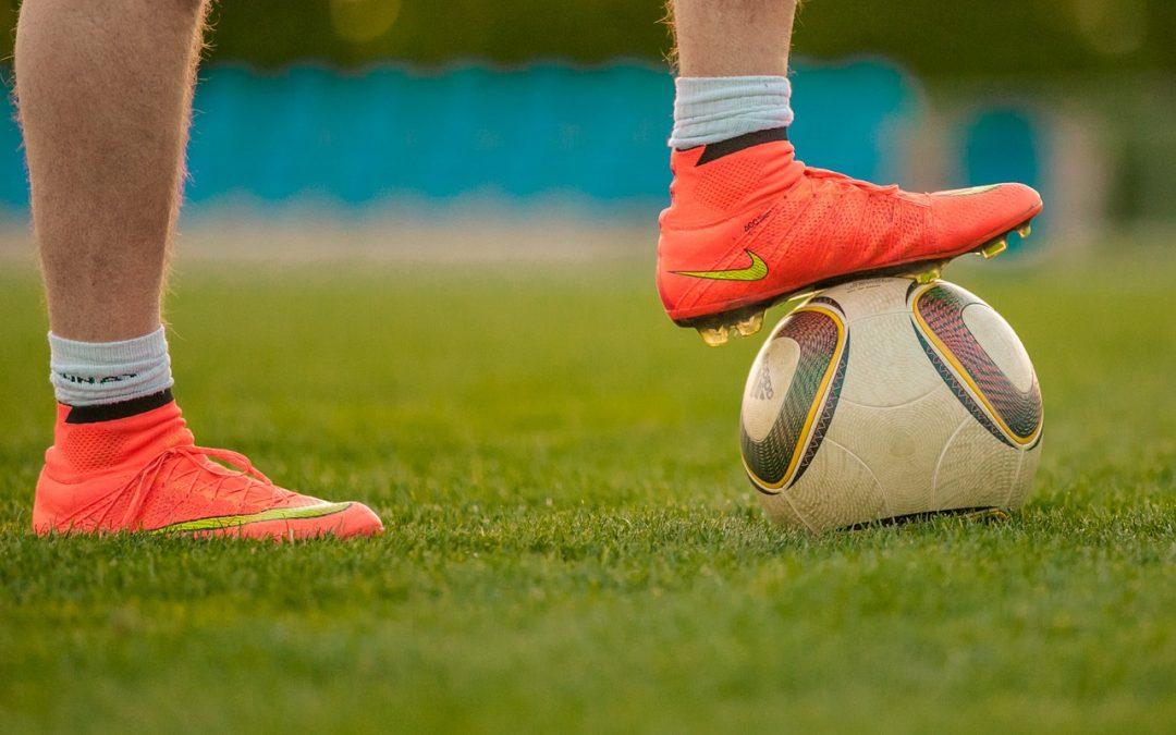 Fotbalové kopačky a sportovní rukavice